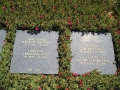Stone tablets each bear the names and dates of two soldiers, if know