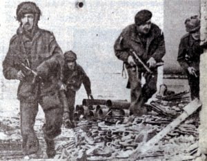 British paratroopers search a ruined house in Oosterbeck