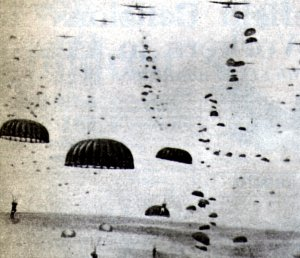 Paratroopers descending from the transport planes
